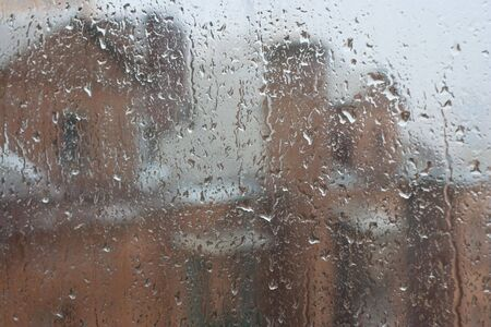 condensation: View trough window to rainy street. Focus on raindrop on glass Stock Photo