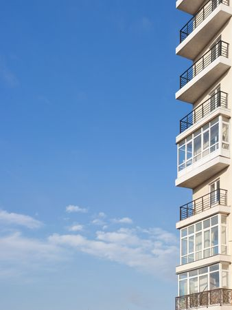 Balcony of new apartment building in Kyiv on blue sky background