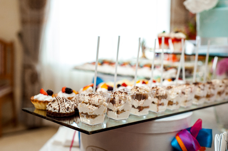 Delicious wedding reception candy bar dessert table different sweets Stock Photo