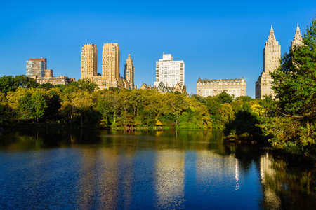 Skyline with apartment skyscrapers over lake in Central Park in midtown Manhattan in New York City