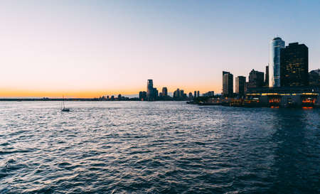 Jersey City from Hudson river during sunset in Jersey City, NJ, USA Banque d'images
