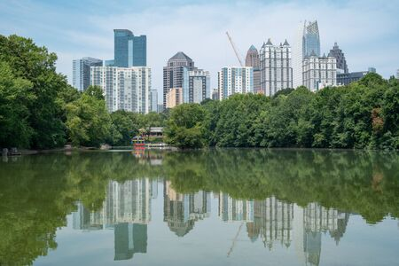 Skyline and reflections of midtown Atlanta Georgia in Lake Meer from Piedmont Park. Stock Photo