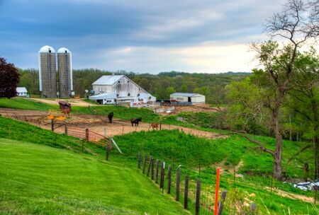 Farms on a hillside in the Iowa countryside during spring