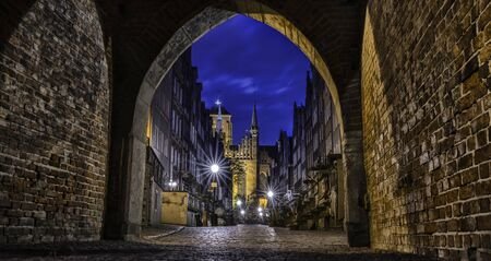 Amazing architecture of the Mariacka street in the old town in Gdansk at night, Poland.