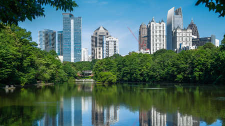 Skyline and reflections of midtown Atlanta Georgia in Lake Meer from Piedmont Park.