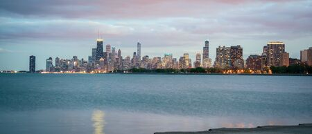 Chicago Skyline as seen from Montrose Harbor, including pier protruding out into Lake Michigan