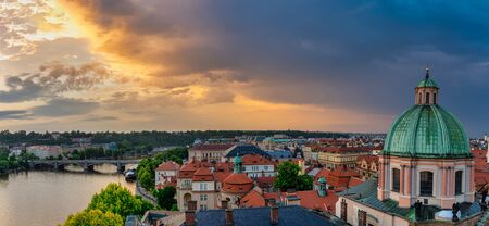 Prague roof tops panorama with The Church of Saint Francis of Assisi in front. 版權商用圖片