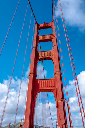 Close up of single tower of Golden Gate Bridge in white clouds San Francisco, USA, bottom view Banque d'images