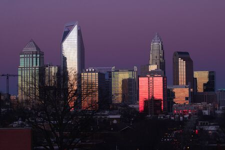 skyline of Charlotte North Carolina at sunset from the west side of the city