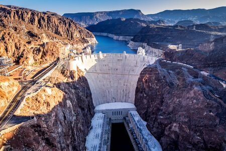 Aerial view of Hoover Dam and infrastructure in Nevada, USA. The dam is capable of producing over 2000 megawatts of electricity.