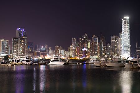 night Cityscape from across the bay in Panama with a serene reflection on the water. Imagens