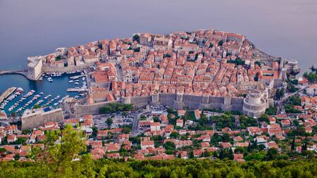 Aerial view of The Old Town of Dubrovnik with City wall, towers, forts and Old Harbour in Dubrovnik, Croatia