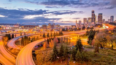 View of Seattle downtown over I5 interstate highway at sunset from Dr. Jose Rizal Park, Washington, USA