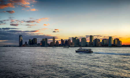 Jersey City from Hudson river during sunset in Jersey City, NJ, USA Éditoriale
