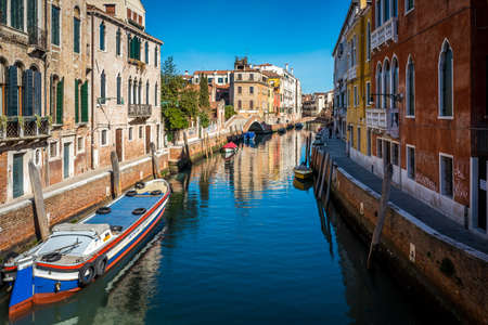 Water channels of Venice city. Facades of residential buildings overlooking the small canal in Venice, Italy.