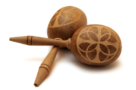 Cuban wooden maracas shot on a white background photo