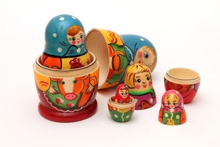 female likeness: colored matryoshka dolls isolated on white background
