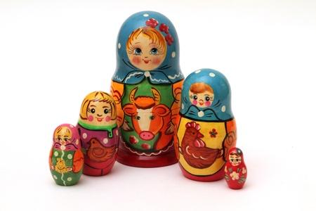 colored matryoshka dolls isolated on white background photo