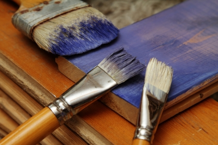 soiled: soiled with paint brushes, boards purple color