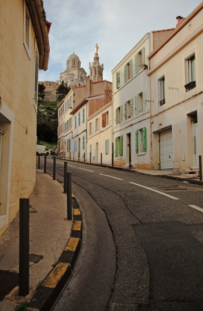 garde: street in Marseille, with the view at  the Notre Dame de la Garde