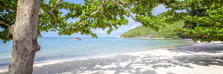 Beautiful amazing incredible tropical beach, white sand, blue sky with clouds and reflection of trees on the sand 版權商用圖片