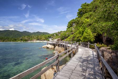 Bright beautiful tropical landscape wooden walkway along the seashore Reklamní fotografie