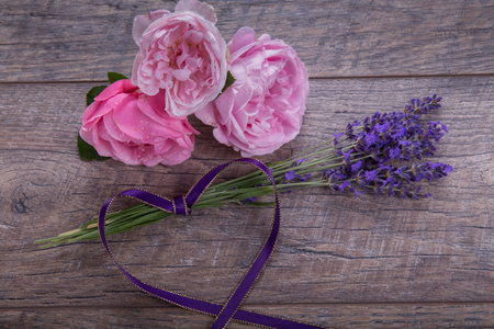 Little bouquet of organic english roses with lavender - nice and beautiful small gift for your women. Copy space. Mothers, Valentines, Womens, Wedding Day concept. Stock Photo