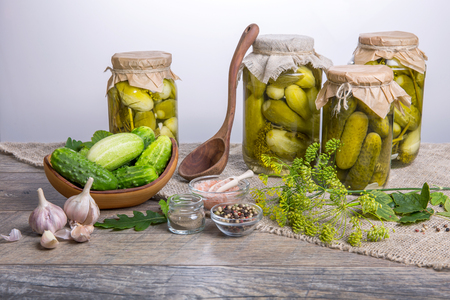 Salted cucumbers. Spices and herbs for making pickles on wooden background