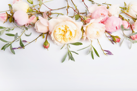 Festive flower composition on the white wooden background. Overhead view Zdjęcie Seryjne