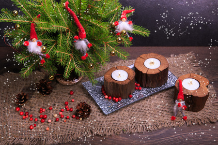 Vintage Christmas or New Year Composition with Christmas Tree, wooden candles and gnomes. Rustic style