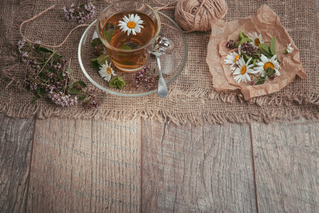 A cup of tea with chamomile on a wooden background. Alternative, traditional medicine Stock Photo