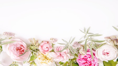 Beautiful English rose flower bouquet composition on white background. Greeting card, invitation in light pastel colors. Copy space. Mothers, Valentines, Womens Wedding Day concept.