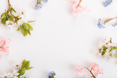 Festive flower composition on the white wooden background. Overhead view Stock fotó