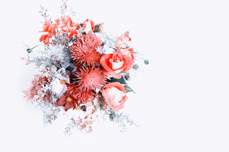 Bouquet of flowers in red. Roses, berries, chrysanthemum, asters, kosmeja, hydrangea, wormwood. Flower composition on white background. Flat lay top view.