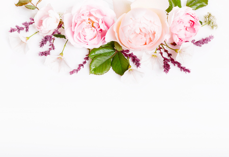 Festive flower composition on the white wooden background. Overhead view Stock Photo