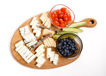 Wooden board with tasty cheese on white background Reklamní fotografie