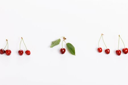 Tropical summer abstract background. Cherry cherries with cuttings and leaves on the white background. Reklamní fotografie