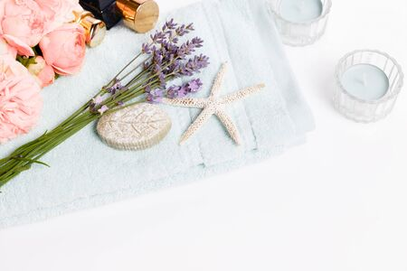 Spa and wellness background, lavender, pink roses, cosmetics on a towel Reklamní fotografie