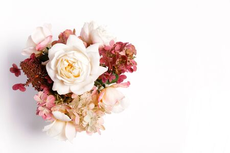 Autumn bouquet of flowers in red, burgundy colors. Roses, hydrangea. Flower composition on white background.