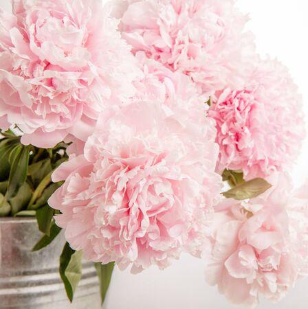 Delicate beautiful pink bouquet of peonies closeup, wedding card, invitation, romantic image.