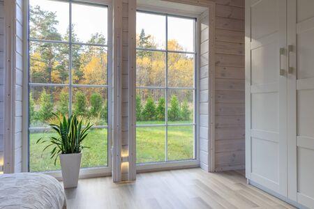 Bright photo studio interior with big window, high ceiling, white wooden floor Banco de Imagens