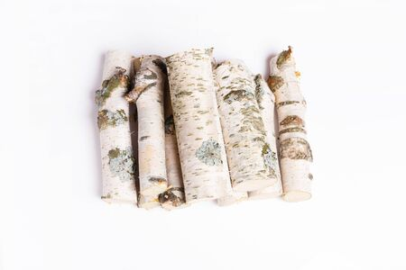 A pile of birch firewood on white background