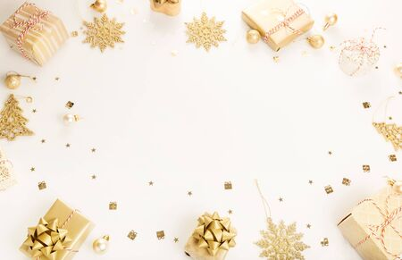 Gift or present boxes and stars confetti on white table top view. Flat lay composition for birthday, christmas or wedding.