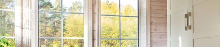 Bright interior, room in wooden house with large window. Banner. Scandinavian style. Foto de archivo - 136175601