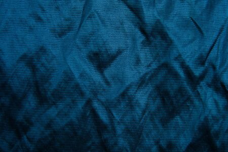 Classic blue fabric blank canvas, compressed silk texture, 2020 fabric trendy color swatch for clothes, interior. Foto de archivo - 136175685