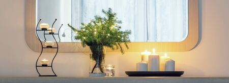 Candles, Christmas tree branches with lights in a vase on the table Foto de archivo - 136175687