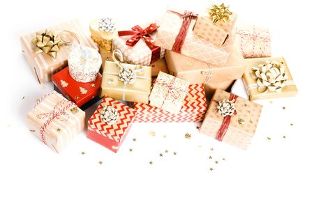 Gift or present boxes and stars confetti on white table top view. Flat lay composition for birthday, christmas or wedding. Foto de archivo - 136175688