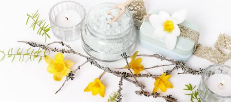 Frame made of branches and yellow spring flowers on white background. Beauty, spring, Easter concept. Flat lay, top view, mock up. Stock fotó