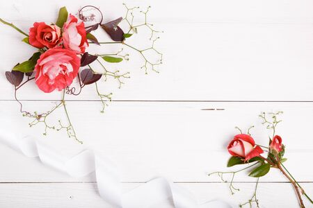 Festive flower composition on the white background. Overhead view Stock Photo
