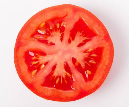 Slice of fresh tomato closeup, isolated on white,
